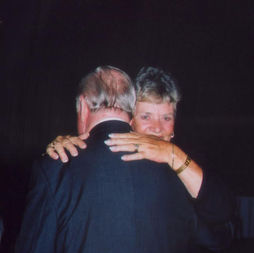 Doris Strickland Collins giving Jerry a hug for us